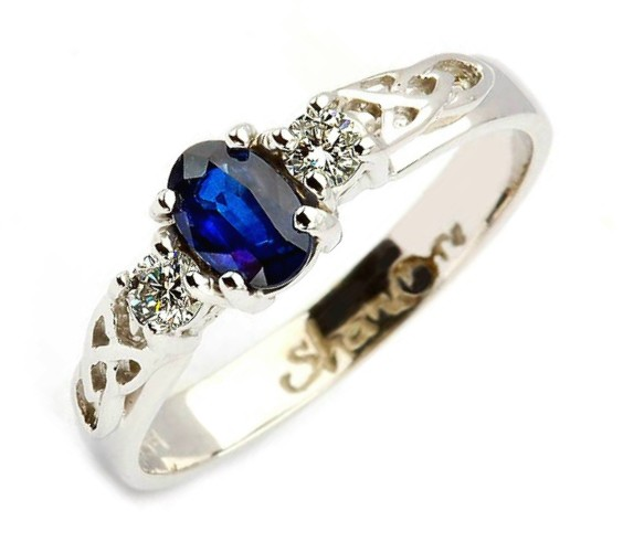 a44643bd3f1f Oval Sapphire and Diamond Trinity Knot Engagement Ring